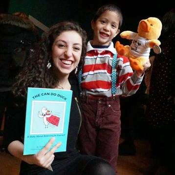 Theater Educator Arielle with The Can Do Duck book